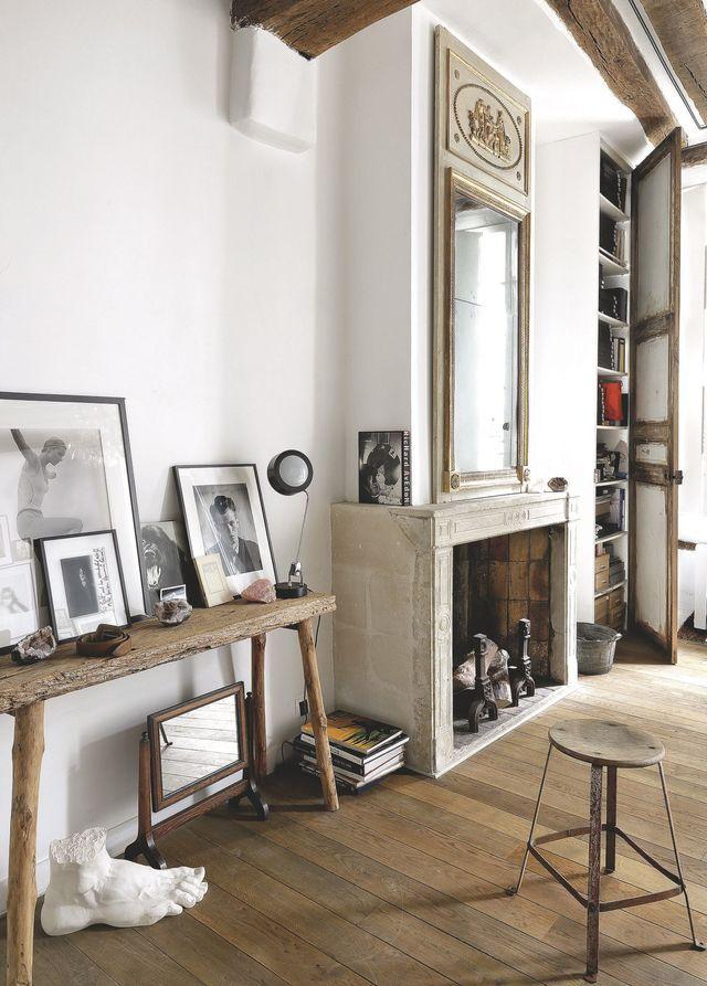 Appartement Marais avec poutres apparentes Salons, Living rooms