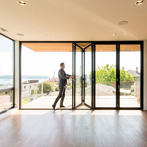 Residential folding swing multi slide doors lacantina for Multiple sliding glass doors