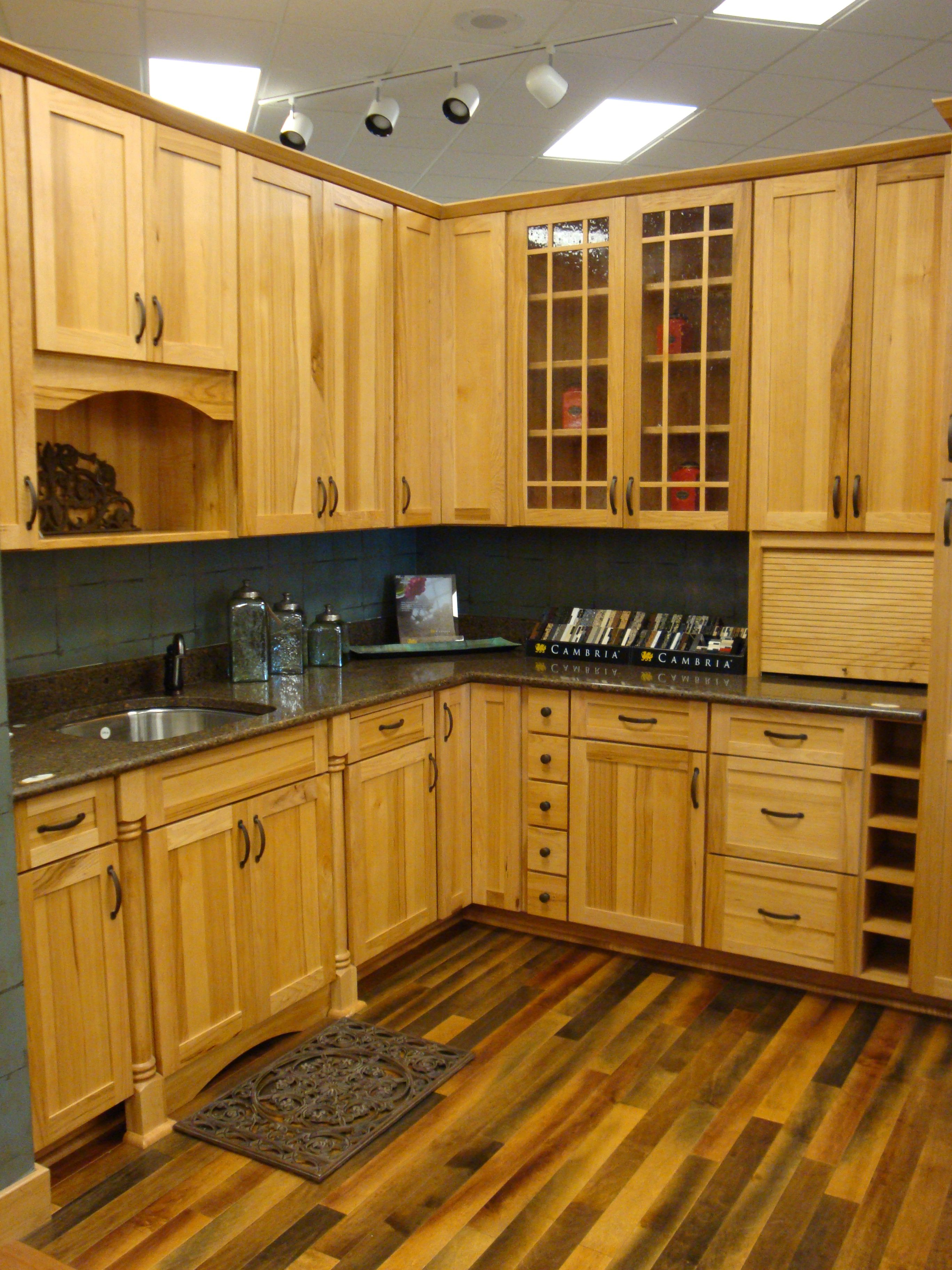 hickory cabinets with a maple hardwood floor  kitchen