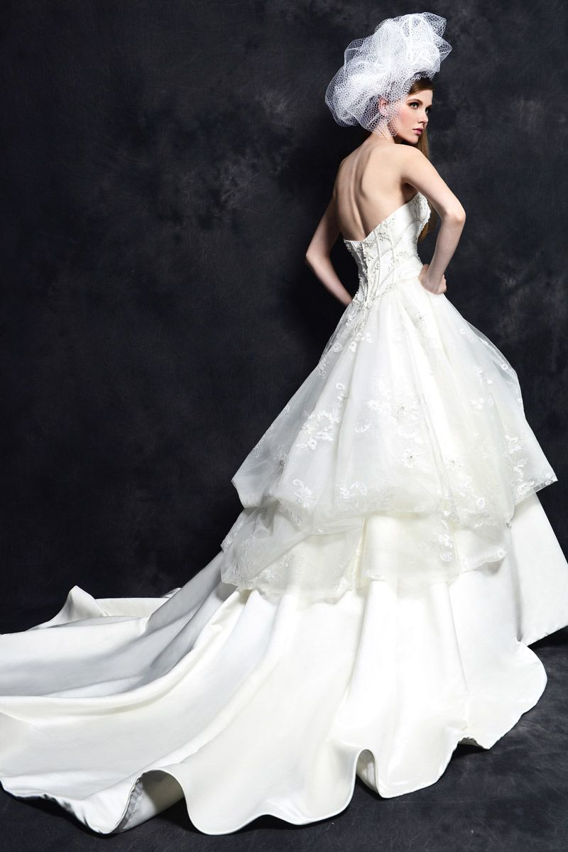 A timeless A-line gown in Royal Duchess Satin and Tulle made with a strapless sweetheart neckline. The bodice has been outlined with boning and embellished with beading. The skirt is made with pick-ups and lace accents and finished with a chapel length train.