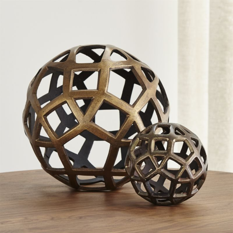 Geo Decorative Metal Balls is part of Metal Home Accessories Living Rooms - Shop Geo Decorative Metal Balls   Pentagons, triangles and squares cluster in an open, decorative metal ball spheres to put the finishing touch on any décor   Centerpiece standouts are made from sandcast aluminum, burnished to bronze