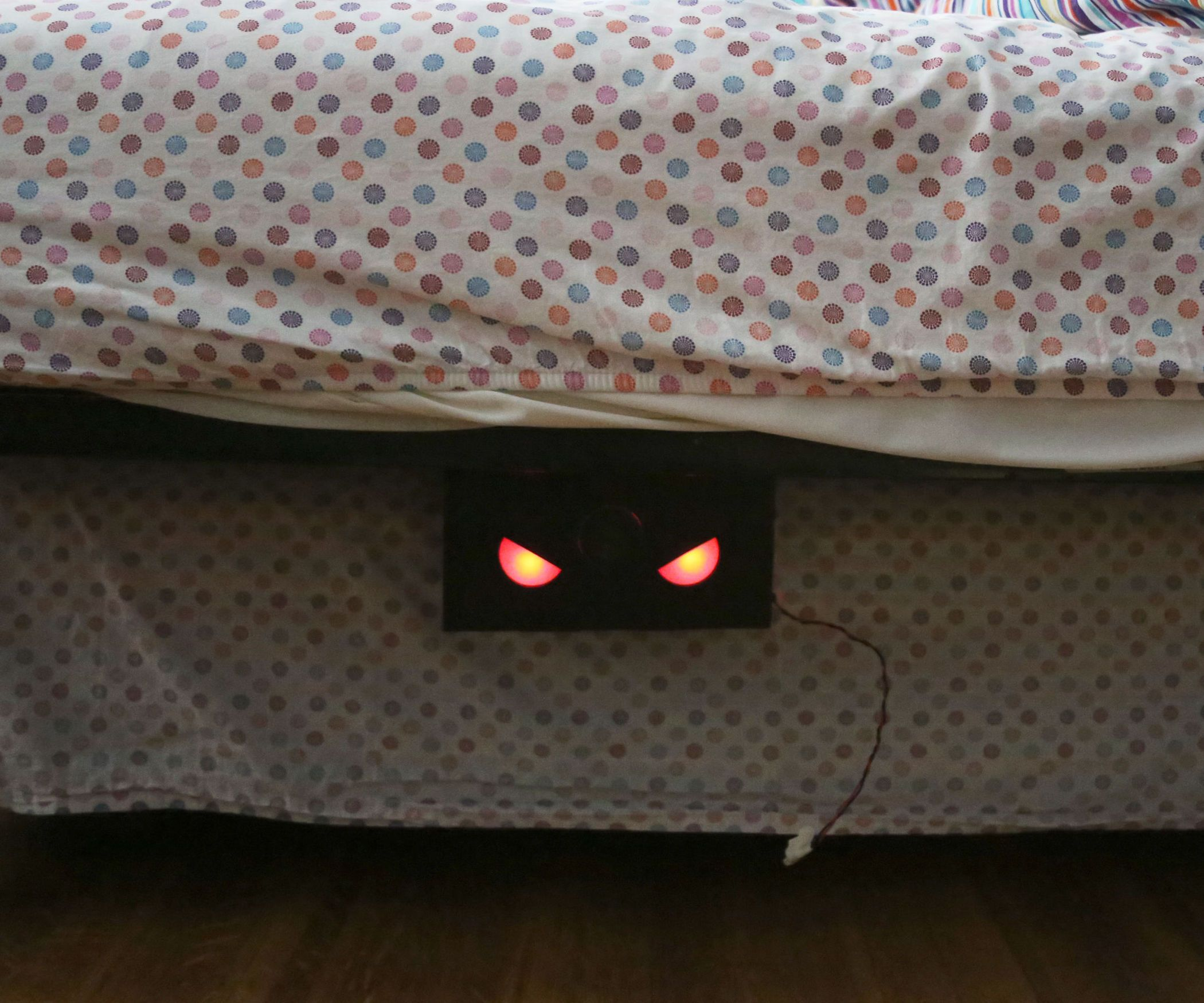 This box makes scary noises and has glowing red eyes that turn on when the lights go out Put it under a bed or desk to prank your friends or colleag