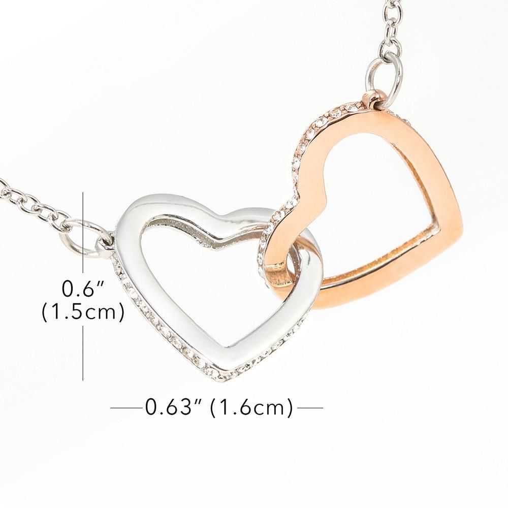 Two hearts embellished with Cubic Zirconia stones, interlocked together as a symbol of never-ending love. Made with high quality 18k Rose Gold and polished surgical steel. Cable chain measures 16 inches with a 6 inch extension, and fastens with a lobster clasp.