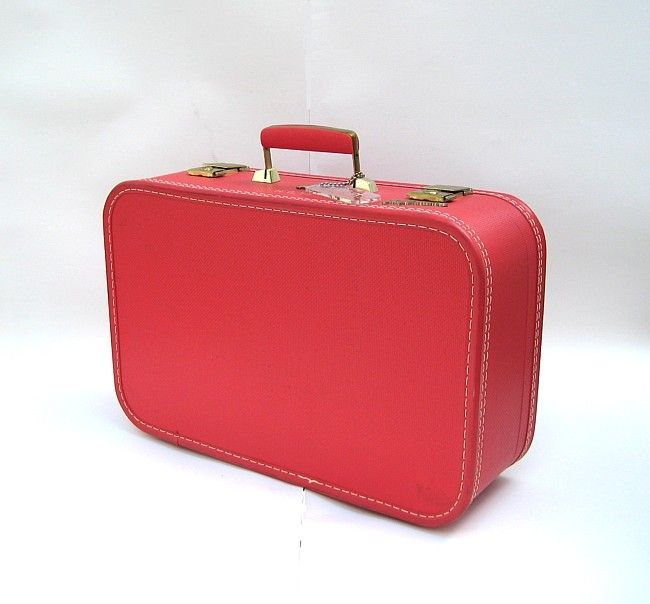 Simple red suitcase, a little edgier, a little less innocent ...