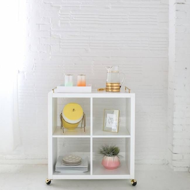 2.) Slap some wheels on a small shelf to transform it into a sweet bar cart