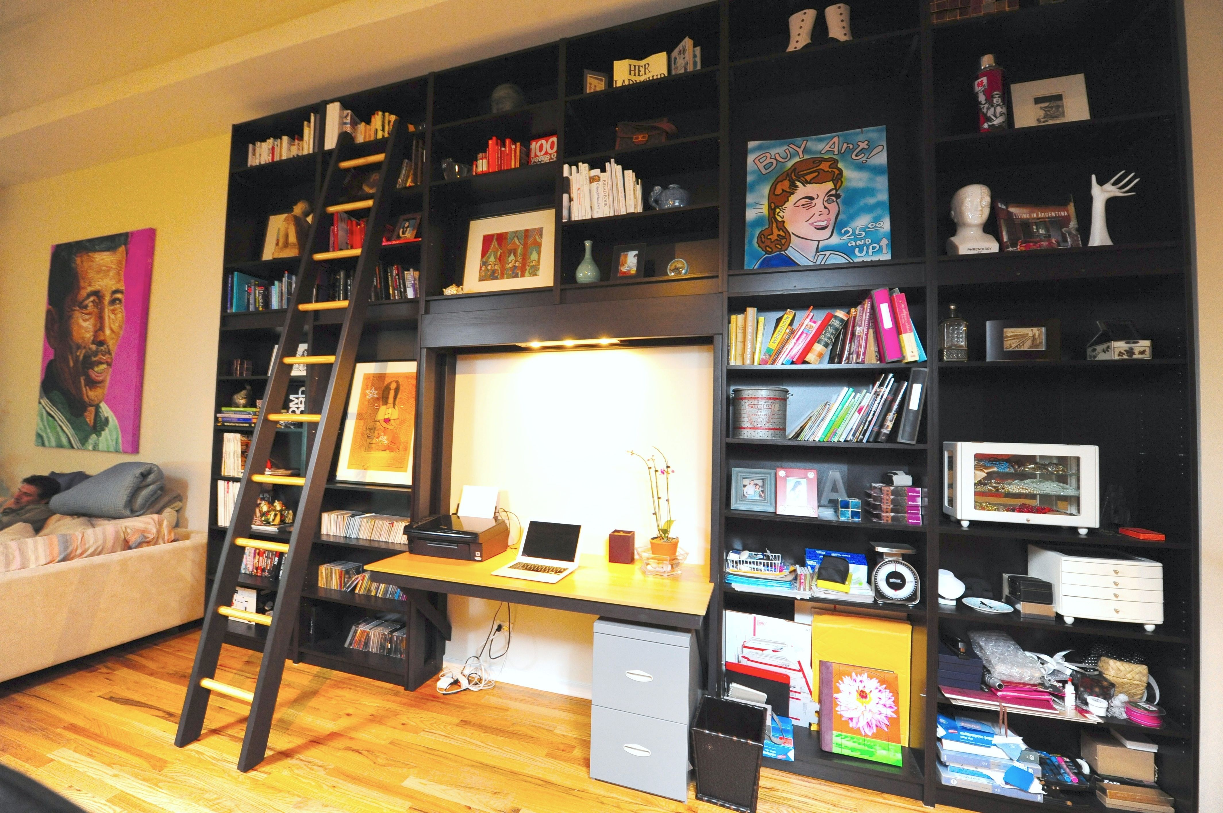 Eleven Ikea Billy Bookshelves Stacked On Top Of Each Other With A