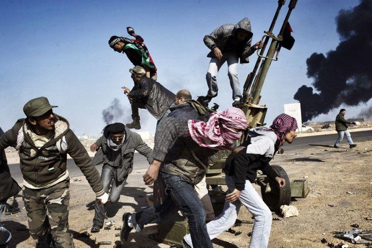 Ras Lanuf, Libya, March 11, 2011. Anti-Qaddafi rebels flee under fire from the Libyan army.    Read more: http://lightbox.time.com/2013/05/07/supporting-photographers-moving-walls/#ixzz2SmuWqmlM by Yuri Kozyrev
