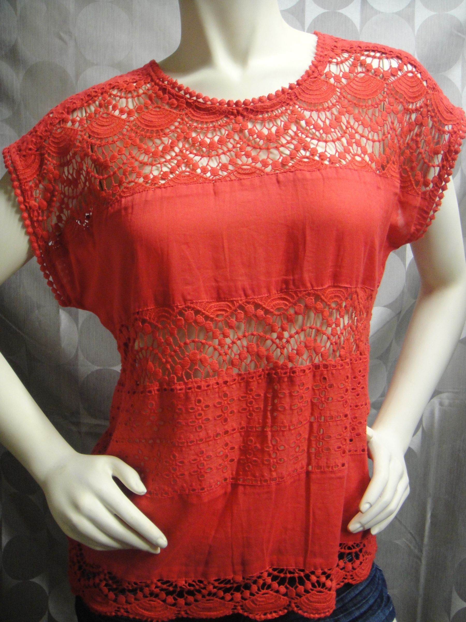 Adorable and lightweight makes it perfect for summer!  Strawberry red in color with cutouts.  Size Medium