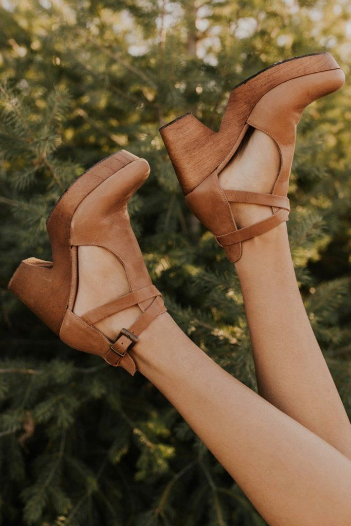 Free People Cedar Clog is part of Clogs - You'll love these classic leather clogs that feature a rounded toe, wooden platform, adjustable ankle strap, and soft footbed   Made in Spain  Available in Taupe, Black, Tan, and Green