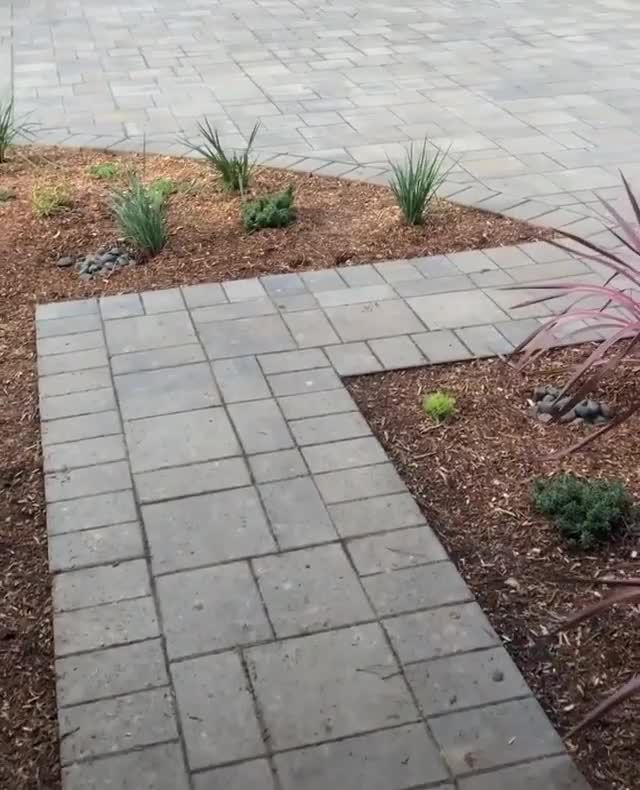 Photo of Landscape Reveal! Paver driveway and Millstone Fountain