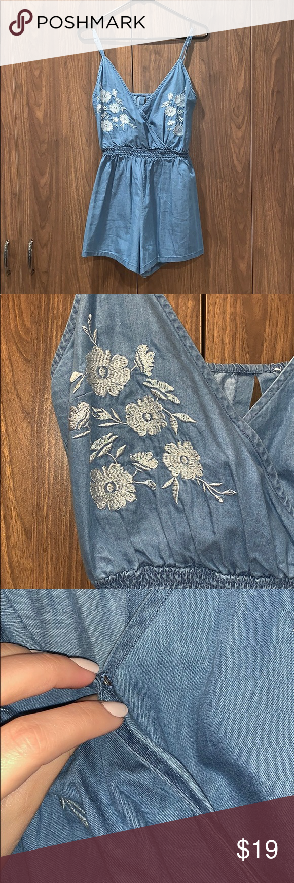 14fb3eed75bb Forever 21 Blue Chambray Floral Embroidered Romper Has a button in the  front to hold the neckline together. Has a surplice looks back has a cutout.