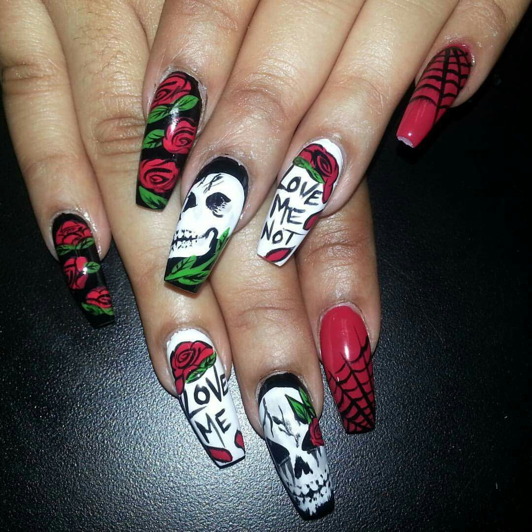 Cool Scary Halloween nail art with skulls and spider webs ...
