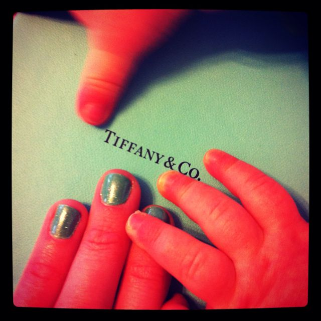 My go at sparkling Tiffany blue nails... And some tiny cute hands as an added bonus for the picture!