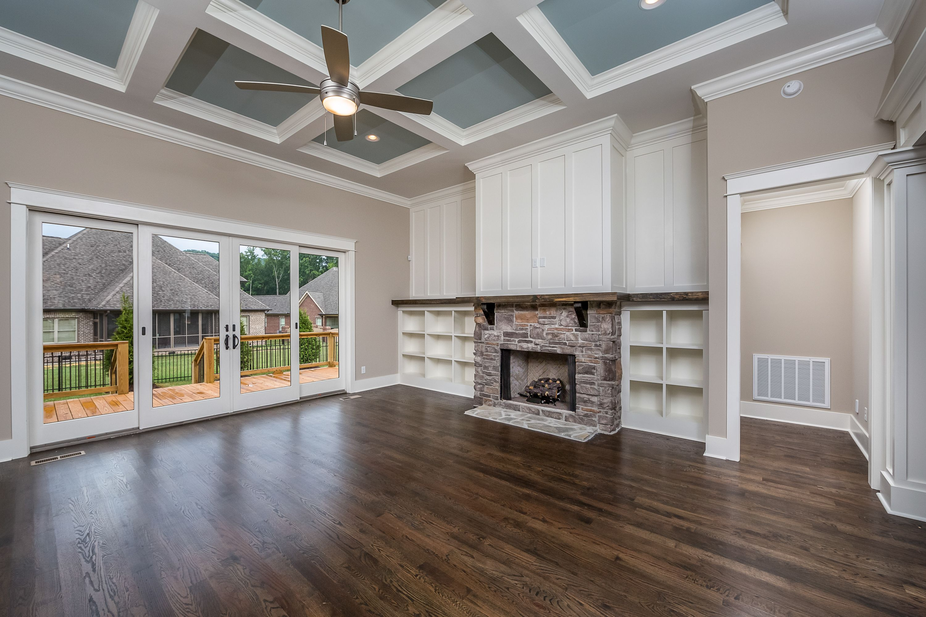 Beautiful Linear Fireplace, Coffered Ceiling, And Modern Tile For Focal