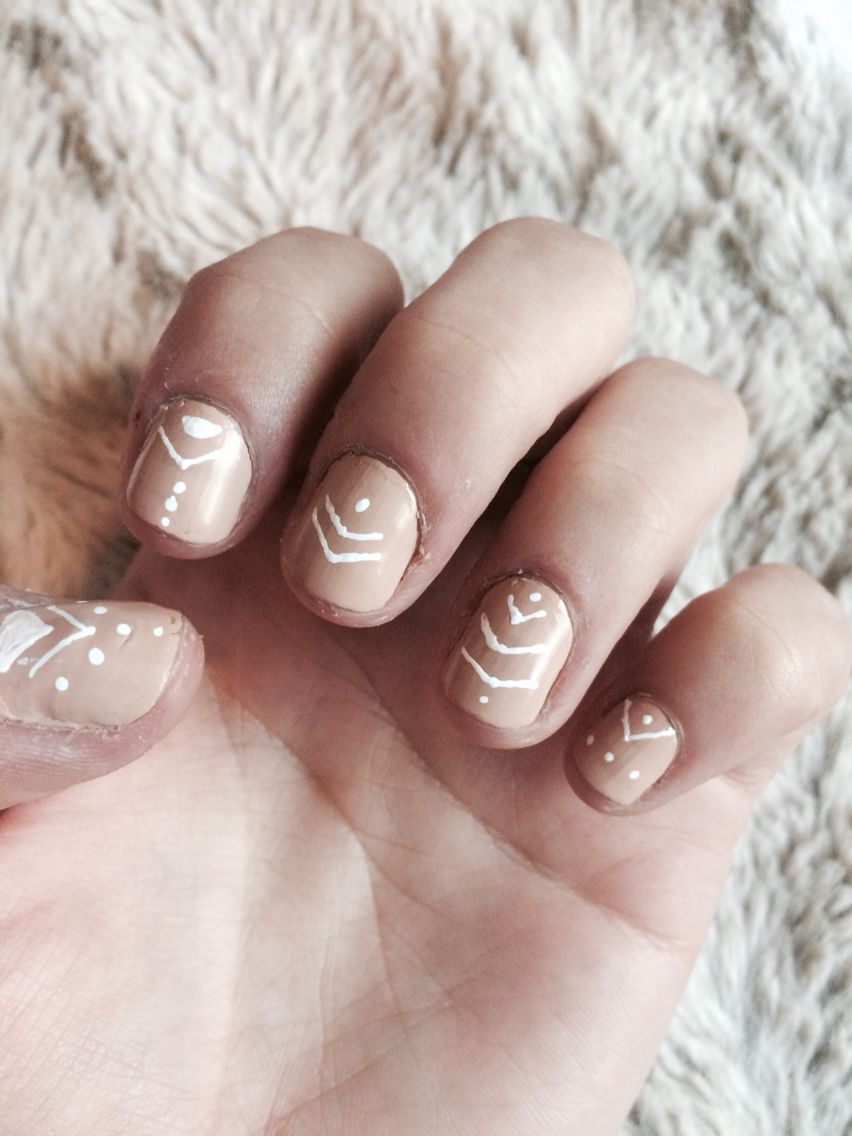Native boho nude and white nail design