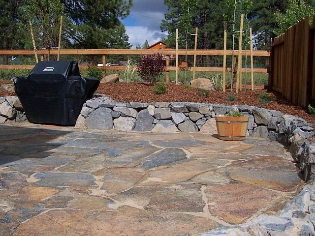 Short Rock Wall Next To Flagstone Patio. I Like The Color Of This Flagstone