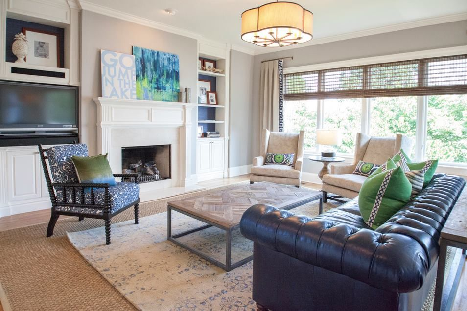 An Elegant Living Room With A Masculine Leather Chesterfield Sofa Is Balanced By Neutral Wingbac Living Room Pictures House Living Room Modern Living Room Sofa