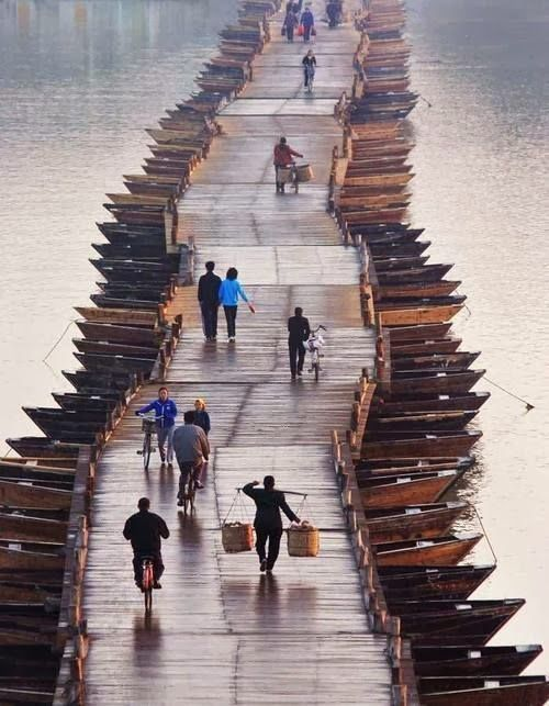 This ancient floating bridge, about 800 years old, sits on the Gongjiang river in Ganzhou, Jiangxi, China.