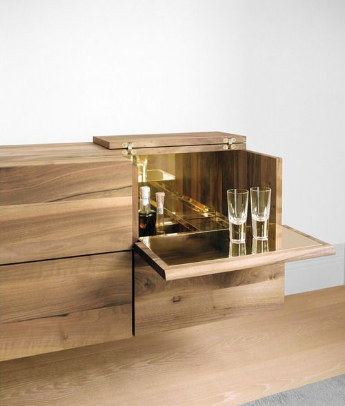 Designer Philipp Mainzer's wall-mounted Araq bar cabinet for e15.
