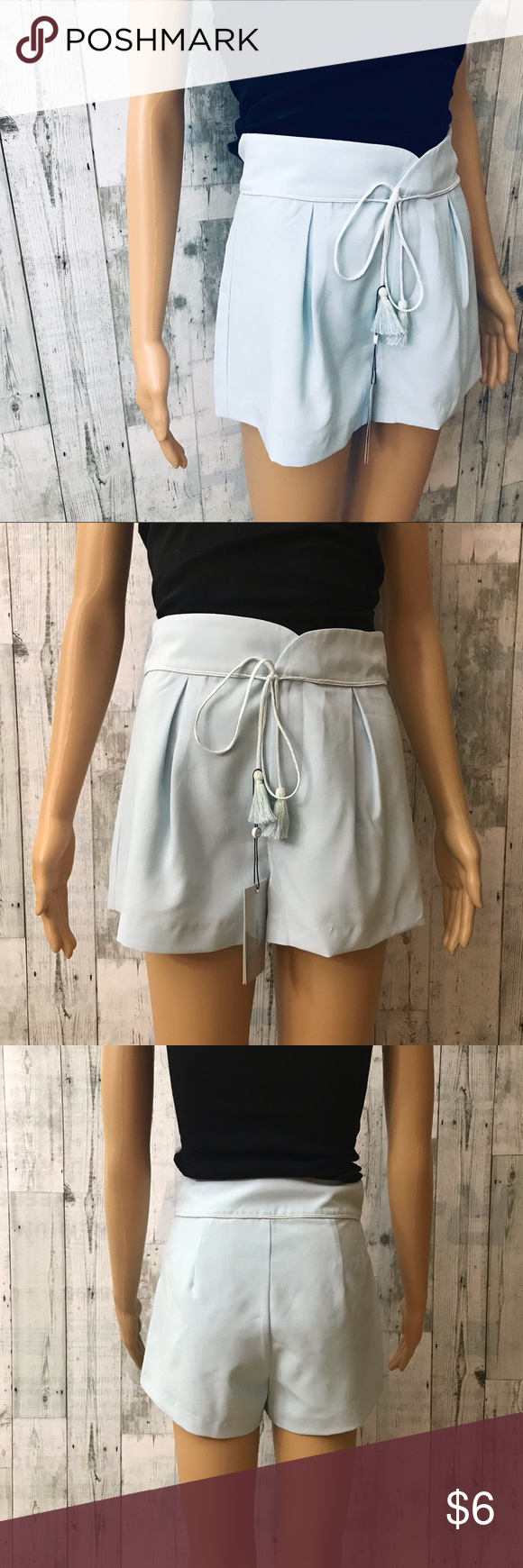 "After Market Light Blue Tassel Shorts Cute light blue shorts with tassels in front, front zip closure, fully lined. Size: S Measurements: 24"" waist, 11.5"" rise, 2"" inseam New with tags 10 After Market Shorts #lightblueshorts"