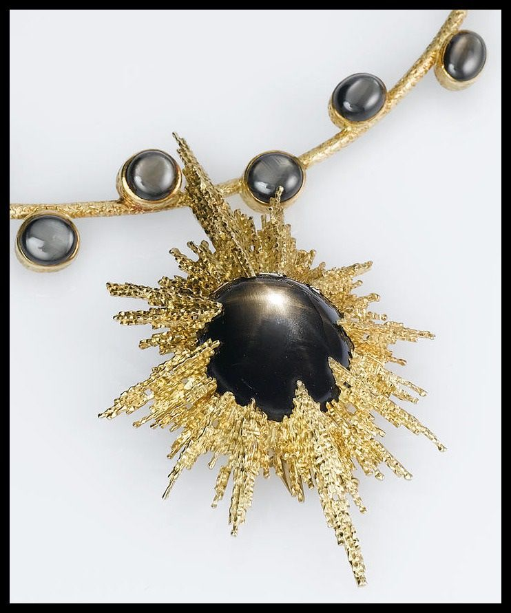 Precious fireworks star sapphires for the 4th star sapphire cabochon black star sapphire and gold necklace by andrew grima circa 1975 aloadofball Choice Image