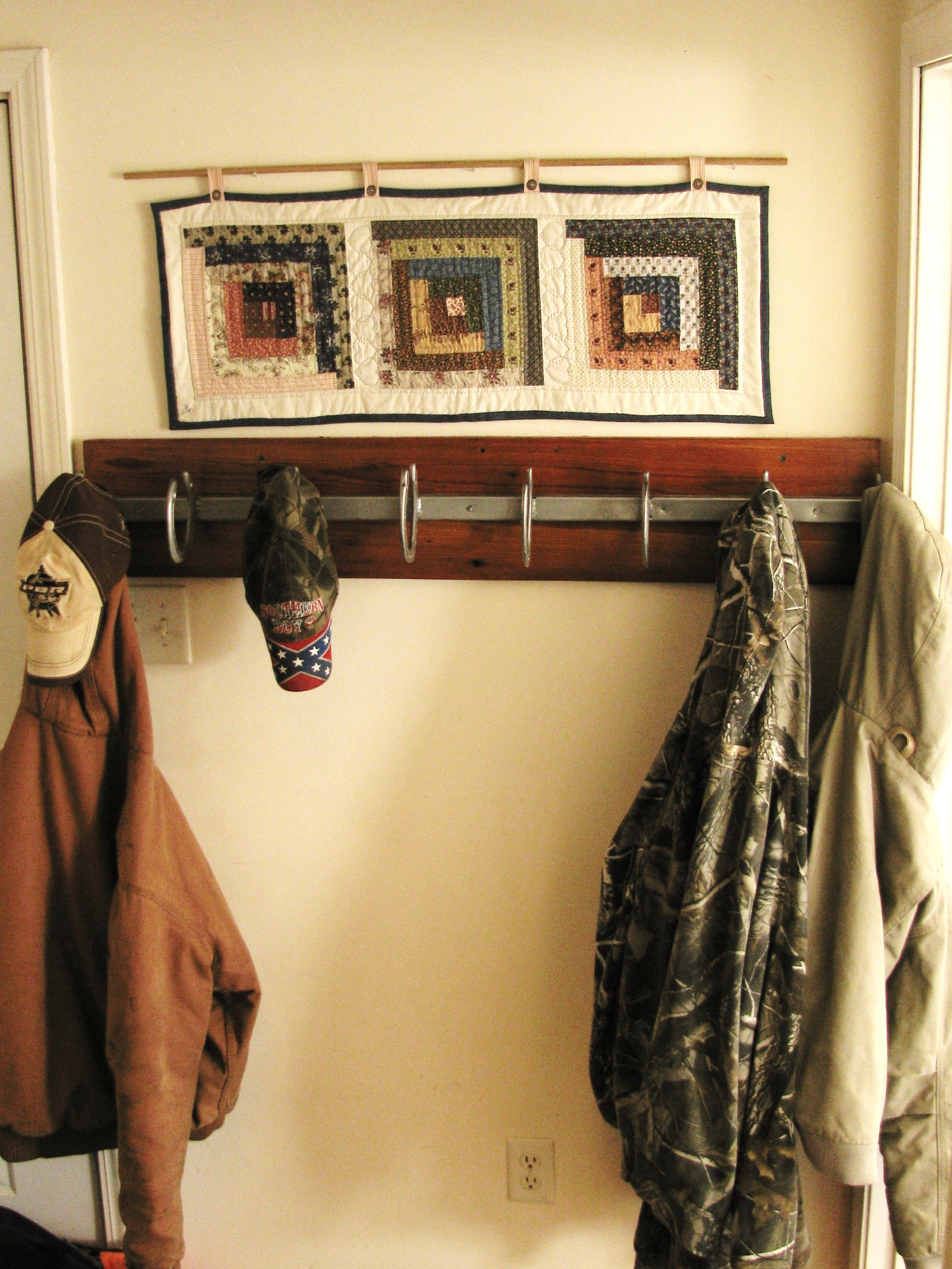 Horseshoe coat rack. We welded the horse shoes on a strong piece of ...