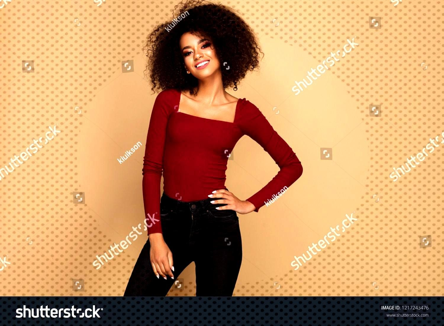 Beautiful african american woman with afro isolated on studio background with copy space ,
