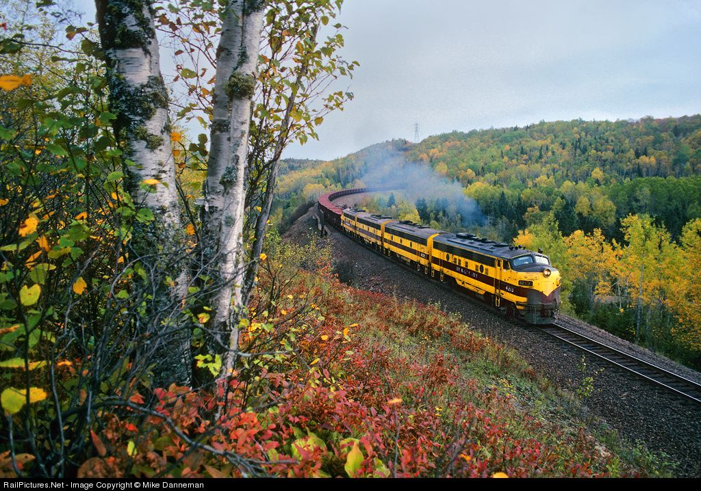 An A-B-B-A set of EMD F9s of LTV Mining Company (former Erie Mining Co.) exit Cramer Tunnel with an empty taconite ore train and curve by some of Minnesota's autumn color on September 24, 1994.