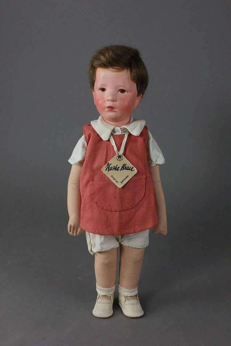 """15"""" cloth bodied boy doll, with hard plastic head, human hair wig, and disc jointed legs, West Germany, 1953-60, by Käthe Kruse."""