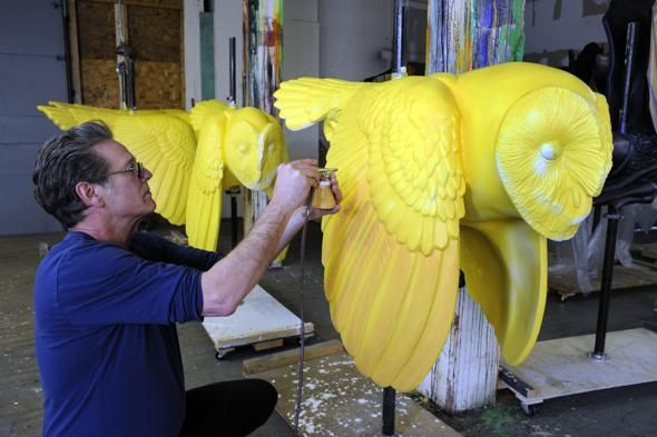 Willian Rogers airbrushed paint onto a barn owl, one of the animals that will appear on the Rose Kennedy Greenway Carousel. Photo by Mark   Wilson for the Boston Globe