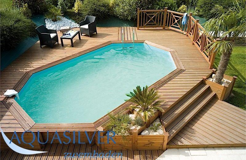 Opbouw zwembad mooi afgewerkt in een houten platteu for Opbouw zwembaden