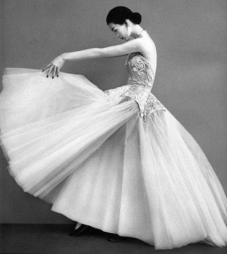 Dovima modeling a Balenciaga ball gown, c.1950. Photograph by Richard Avedon.