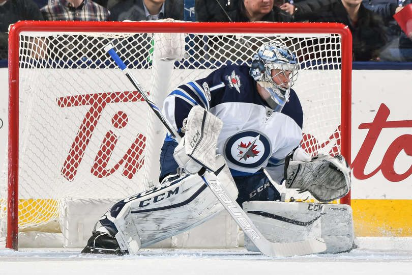 COLUMBUS, OH - APRIL 6: Goaltender Eric Comrie #1 of the Winnipeg Jets defends the net against the Columbus Blue Jackets on April 6, 2017 at Nationwide Arena in Columbus, Ohio. (Photo by Jamie Sabau/NHLI via Getty Images)
