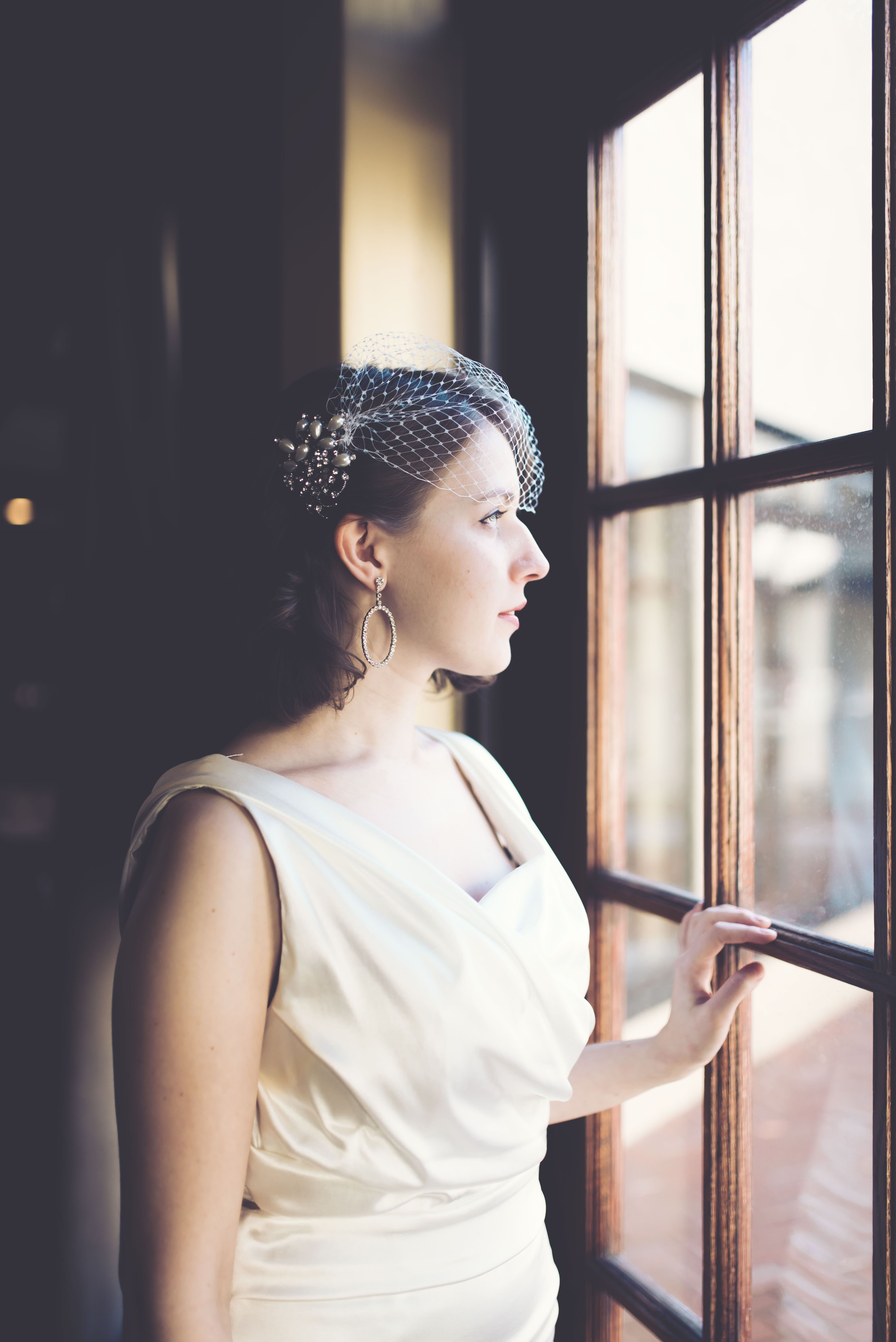 Bird cage veil vintage bride satin dress red lips short hair