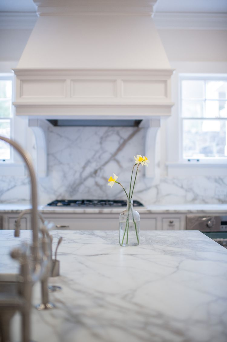 Architecture and Interiors by Krumdieck A+I  www.krumdieck.com Kitchen Marble White Marble Custom Hood Hood Cooktop Gas Cooktop