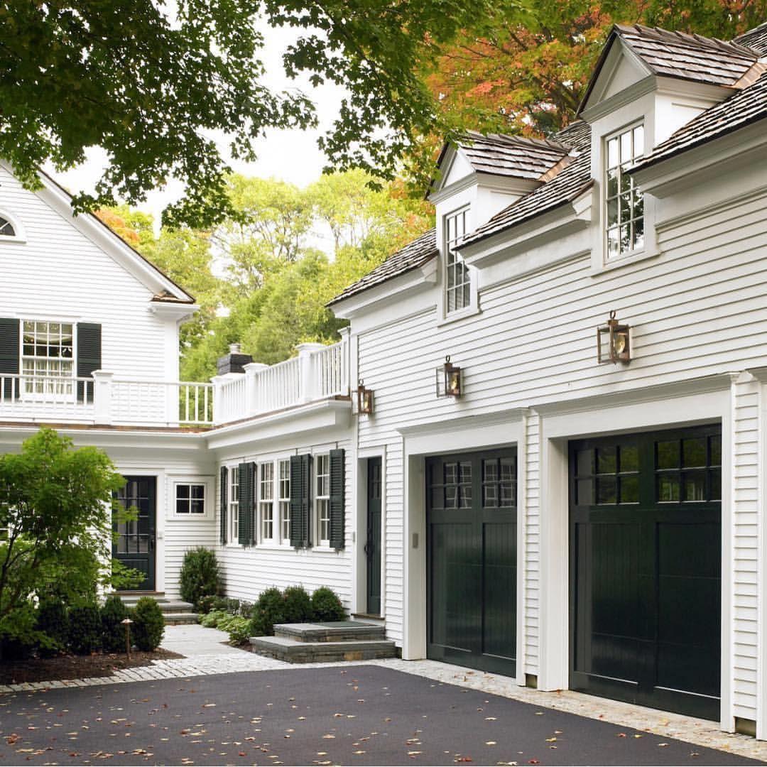 Grey house black garage doors - White Exterior Dark Green Garage Doors And Shutters