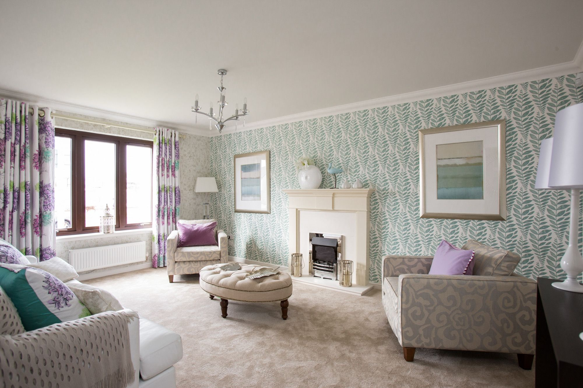Simple yet stylish lounge featuring a soft fern design wallpaper ...