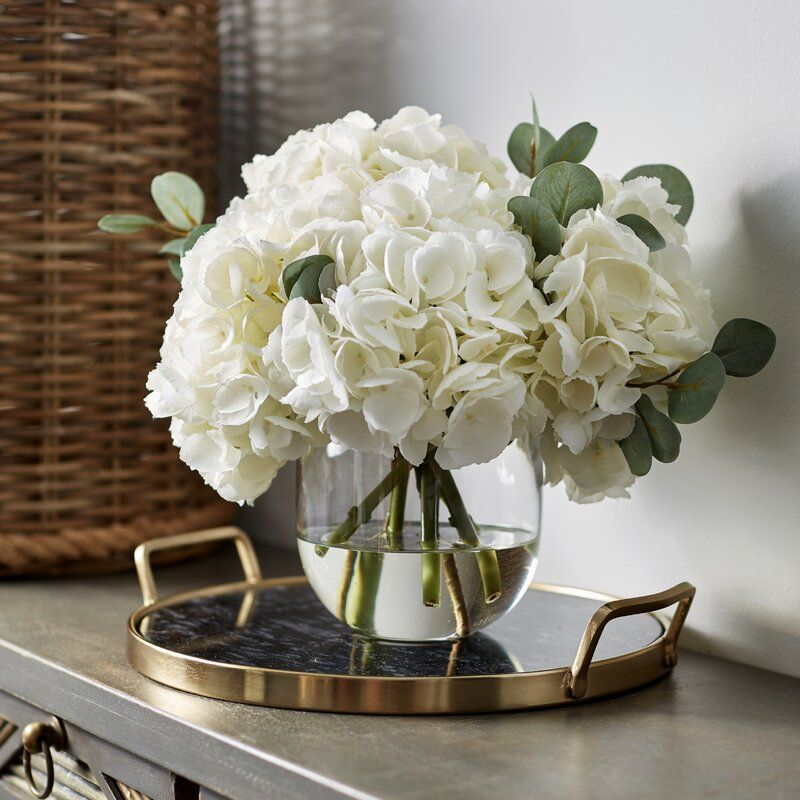 Large White Hydrangea Eucalyptus Arrangement In Rounded Glass Vase Table Flower Arrangements Dining Room Table Centerpieces Table Centerpieces For Home