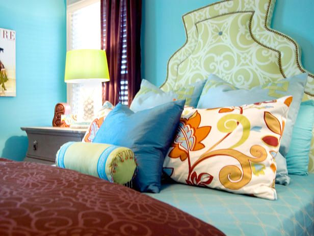 """The """"Tiffany Box"""" blue walls and fun patterns are combined beautifully with chocolate brown curtain and duvet cover."""