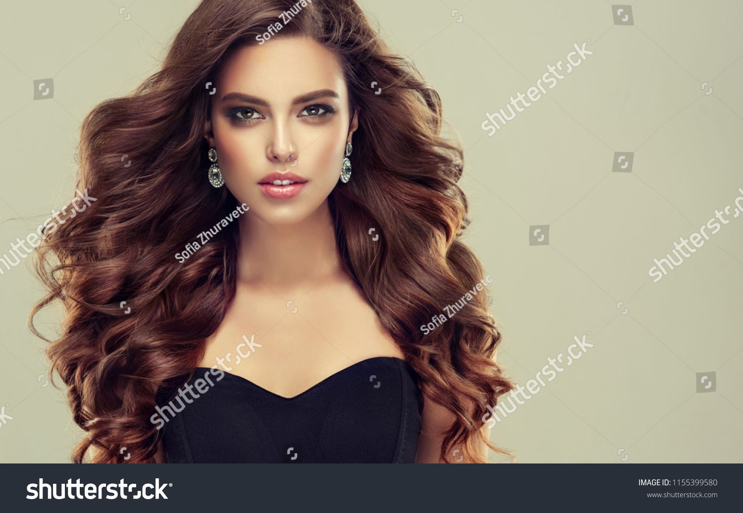 Brunette Woman With Long Healthy And Shiny Curly Hair