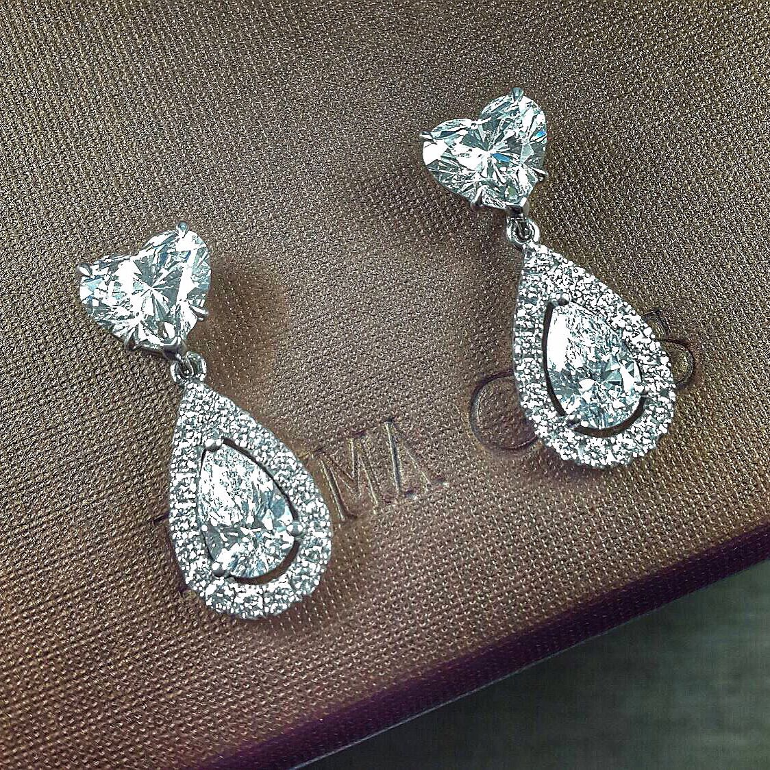 A gorgeous pair of diamond earrings set with 1carat heart shaped and 0.50carat pear shaped diamond from #PrimaGems #gorgeous #sweet #earrings #diamond #heartshape #pearshape #finejewelry #jewelry