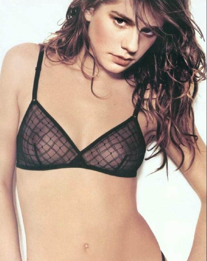 Anna Paquin looking Sexy in a Sheer Black Bra and messy bed head Hair