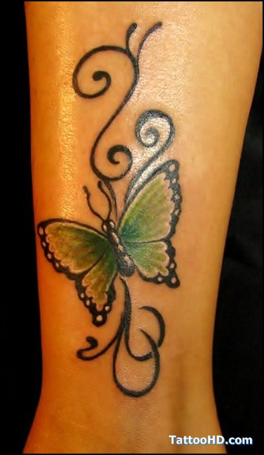 Butterfly Tattoos On Shoulder Blade This Looks Like A Leg Or Arm