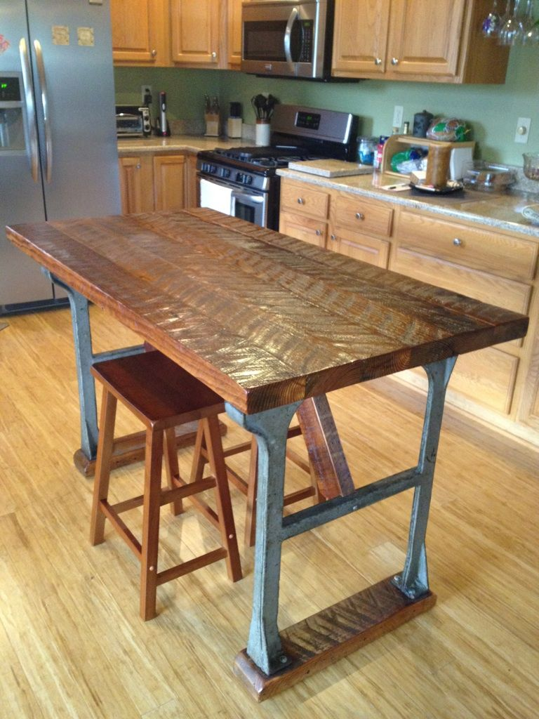 kitchen island made from antique cast iron base with antique