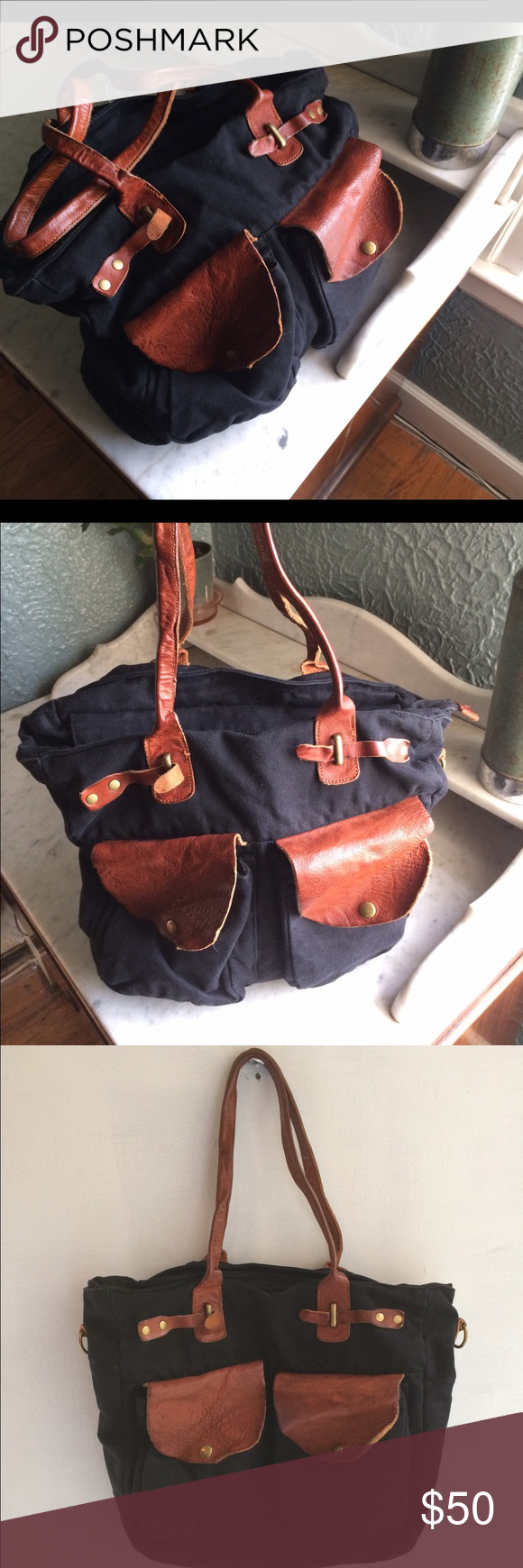 Black canvas and leather Anthropologie bag Made by Jesslyn Blake. This bag has been a great go to travel bag and purse.  Very clean interface and no damage. Black canvas and rustic amber colored leather.                            My Favorite Bag!' Jesslyn Blake Bags Totes