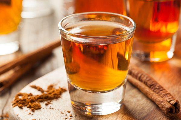 Cinnamon Whiskey Bourbon in a Shot Glass by Brent Hofacker - Photo 147317809 - 500px