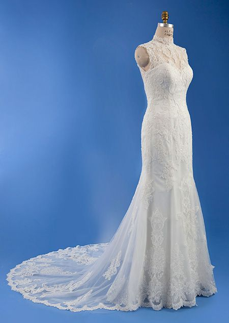 Stunning A sleeveless fit and flair wedding dress features a lace overlay and train embellished with embroidery