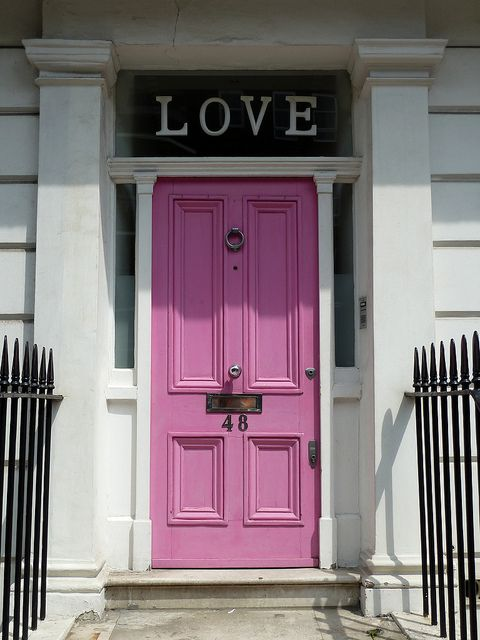 "A pink door beneath the word ""LOVE"" on Oakley Street in Chelsea"