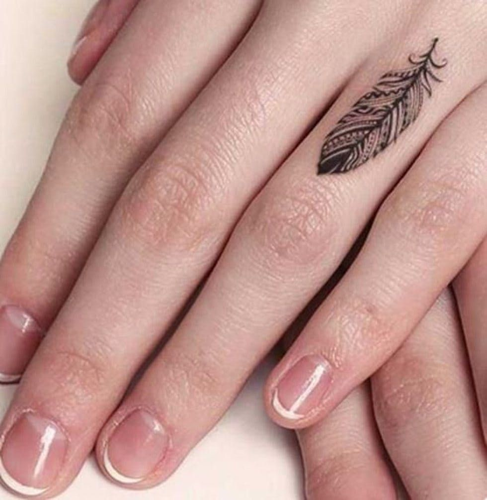 50 delicate and tiny finger tattoos to inspire your first
