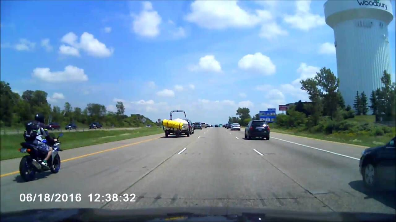 Rider goes airborne after running over unsecured load